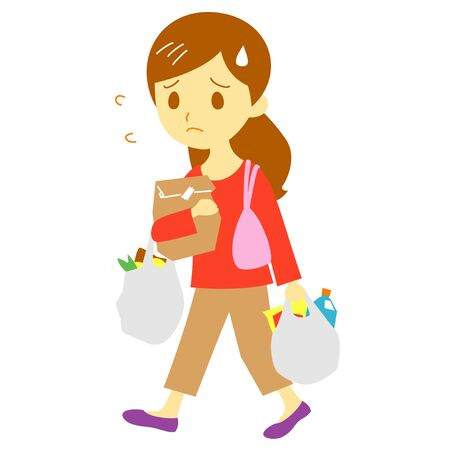 重い買い物袋、図を運ぶ若い女性 写真素材