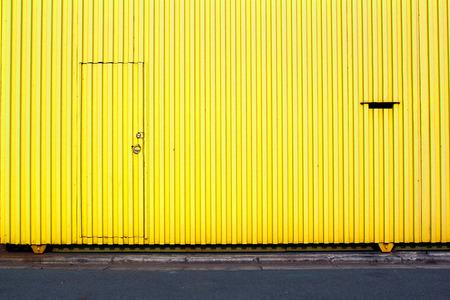 latticed: Yellow siding and a latticed window