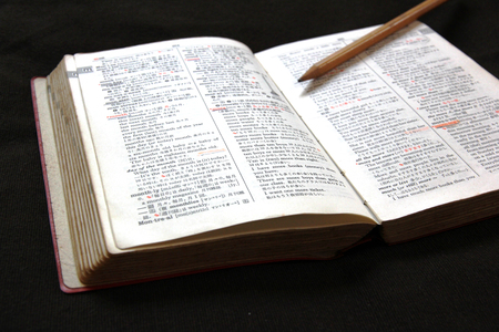 Dictionary and pencil