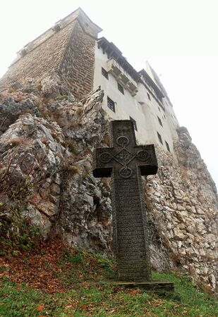 stone cross letters rock wall castle bran romania dracula