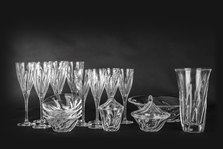 crystal glass: Utensils from crystal glass on a black background Stock Photo