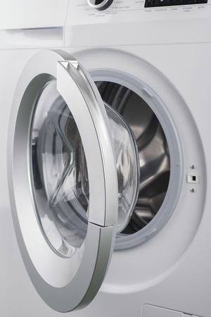 major household appliance: New solated washing machine on a white background