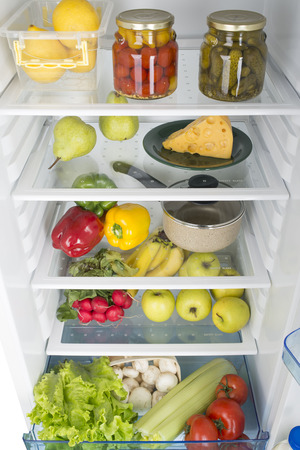 icebox: Open fridge full of fresh fruits and vegetables, healthy food background, organic nutrition, health care, dieting concept Stock Photo