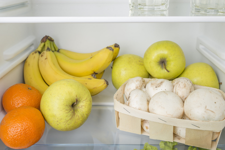 major household appliance: Open fridge full of fresh fruits and vegetables, healthy food background, organic nutrition, health care, dieting concept Stock Photo