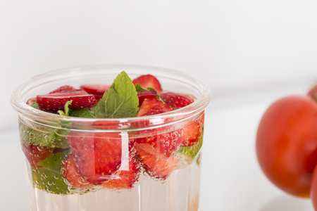 major household appliance: A fresh strawberry cocktail is in the open refrigerator