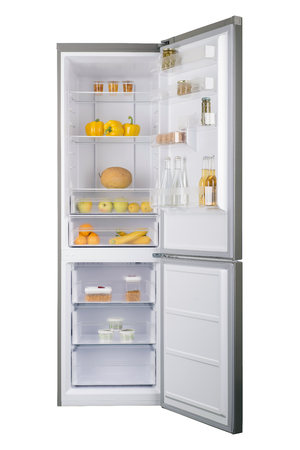 Open fridge full of fresh fruits and vegetables, healthy food background, organic nutrition, health care, dieting concept 免版税图像
