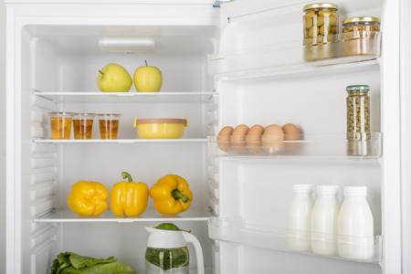 Open fridge full of fresh fruits and vegetables, healthy food background, organic nutrition, health care, dieting concept Foto de archivo