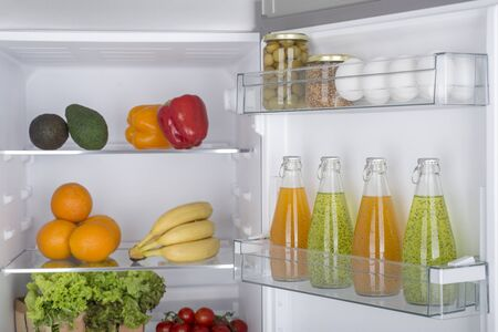 Open fridge full of fresh fruits and vegetables, healthy food background, organic nutrition, health care, dieting concept