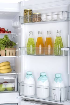 Open fridge full of fresh fruits and vegetables, healthy food background, organic nutrition, health care, dieting concept 版權商用圖片