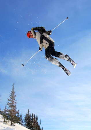 flight helmet: Skier jumping freestyle high in the air