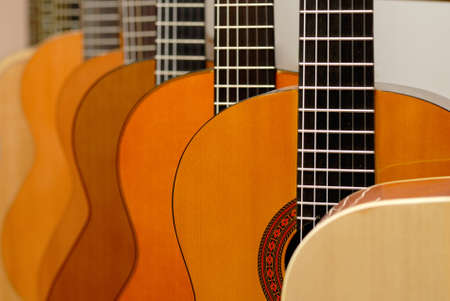 Row of classical guitars in musical store. Close-up view. photo
