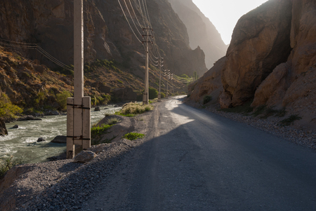 bumpy road: Old bumpy road in mountain canyon in evening light Stock Photo