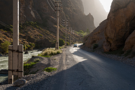 bumpy road: Car on the bumpy road in mountain canyon in evening light
