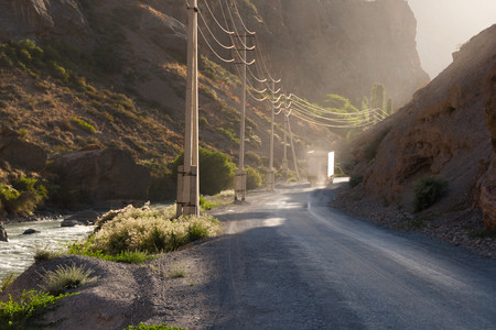 bumpy road: Freight truck on the bumpy road in mountain canyon in evening light