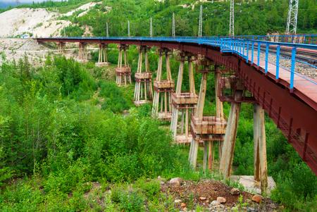 mainline: Devils bridge on the Baikal-Amur Mainline leg of Trans Siberian Railroad in Buryatia, Siberia, Russia Stock Photo