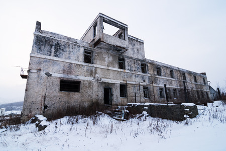 Abandoned settlement with decayed buildings in Kolyma winter view