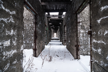 Interior of old abandoned prison in Kolyma. Place for walking Stock Photo