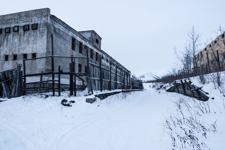pokey: Exterior of old decayed abandoned prison in Kolyma in evening light