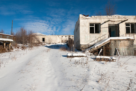 bldg: Abandoned prison settlement with decayed buildings in Northern Kolyma winter view Stock Photo