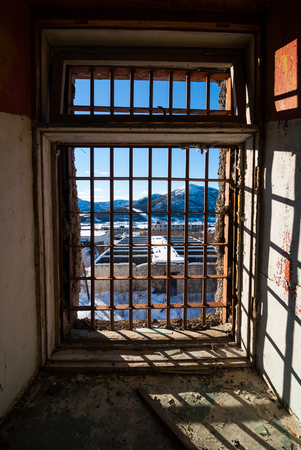 pokey: View through latticed window of abandoned prison in Kolyma