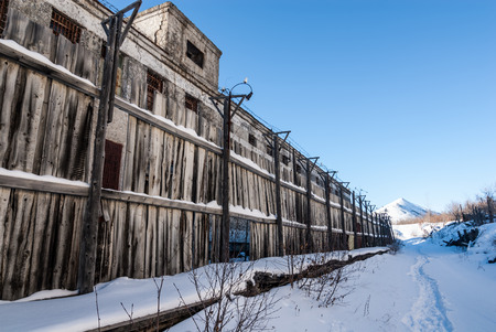 Decayed wooden fence of abandoned prison in Kolyma