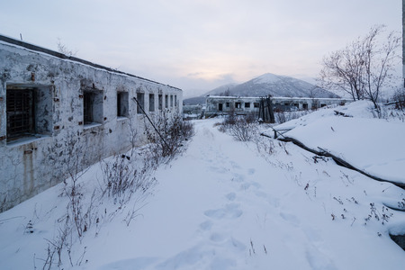 bldg: Abandoned prison settlement with decayed buildings in Kolyma winter view Stock Photo