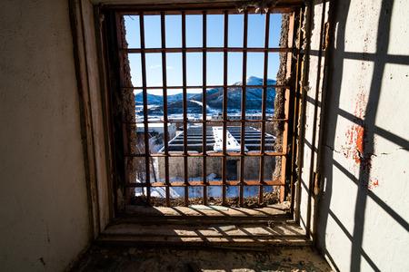 latticed: View through latticed window of abandoned prison in Kolyma