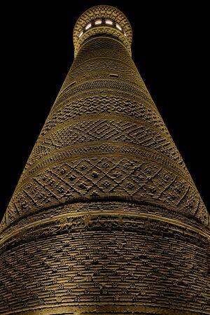 Kalyan minaret in Bukhara. Old ancient minaret in electric lights. Night view.