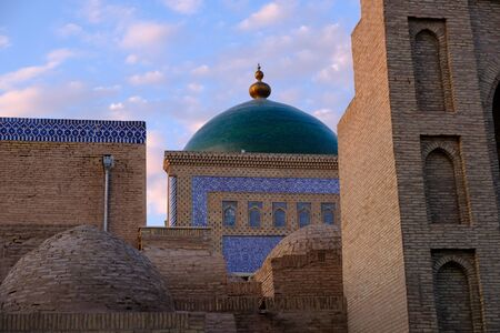 Roofs and cupolas of old town in sunset light, in Khiva, Uzbekistan. Central Asia travel view Stok Fotoğraf