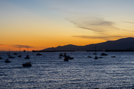 Boats and yachts in the bay at sunset Stock Photo