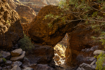 Hiking in Gorge Masca. huge boulders cover the trail Volcanic island. Mountains of the island of Tenerife.