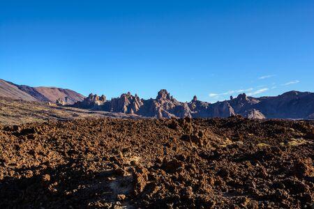 Black frozen lava of the volcano close up