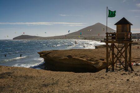 Aerial view of Kitesurfing on the waves of the sea. Kitesurfing, Kiteboarding action photos. Tenerife Spain.