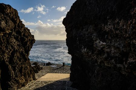 path to the ocean between the rocks. passage to the ocean.
