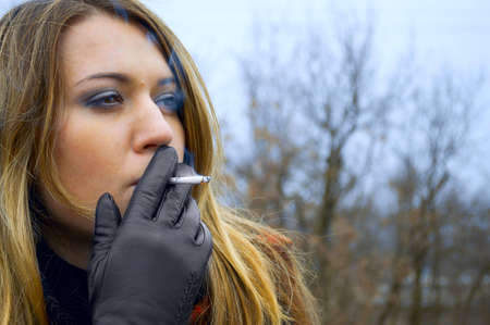 women smoking: The young beautiful girl with a cigaret