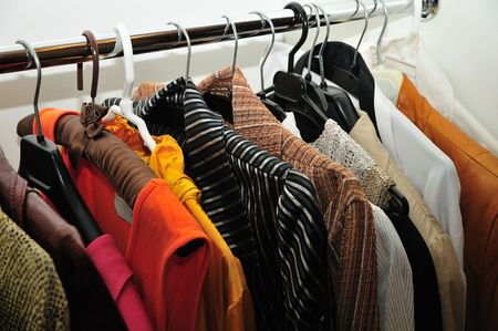 bright colourful clothes hanhing in the wardrobe Stock Photo - 7326473