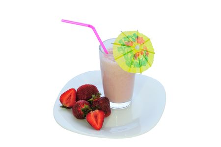 isolated glass of strawberry milkshake on a plate photo