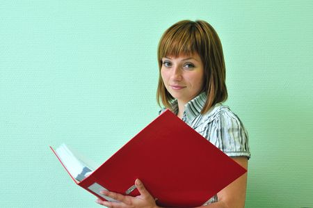 woman with a red folder on the green background photo