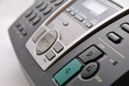 close up of black telephone fax with buttons photo