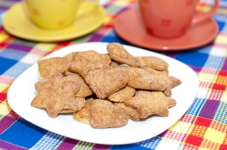 cookies on a plate with two cups photo