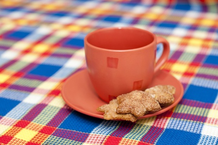 red cup with a heap of cookies photo