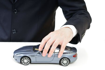 man with a gray toy car in the hand photo