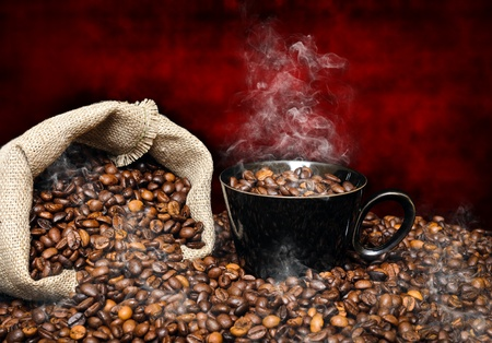 coffee beans with black cup and sack with smoke photo
