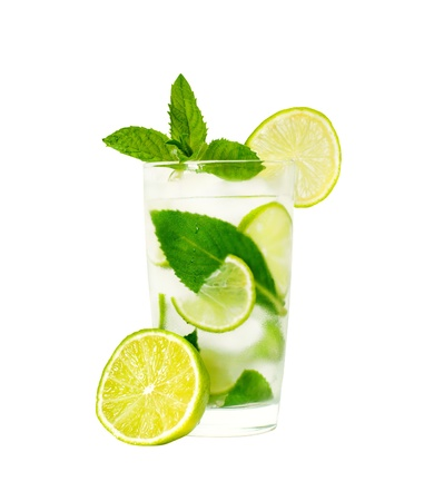 isolated glass of water with mint leaves and lime photo