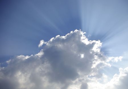 apparition: Rays of sunlight through clouds Stock Photo
