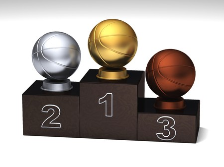 Basketball dark wood podium with trophies on a white floor