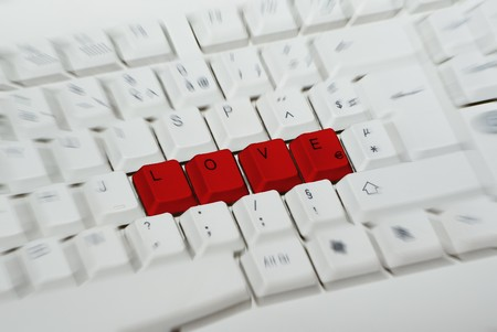 Word LOVE writed with red keys Stock Photo - 7062037