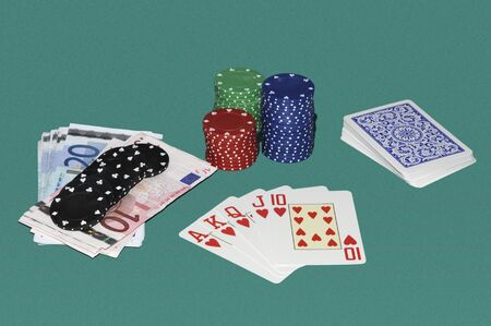 bets: Poker gaming table with cards, bets and red quint flush