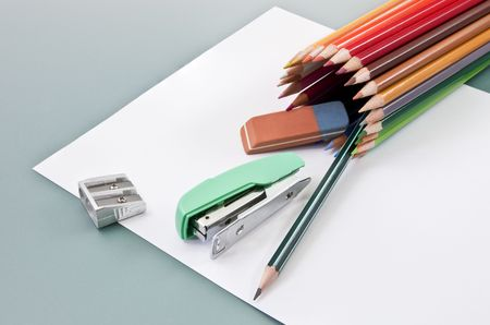 outgoing: School supplies on a white paper outgoing of colored pencils tube