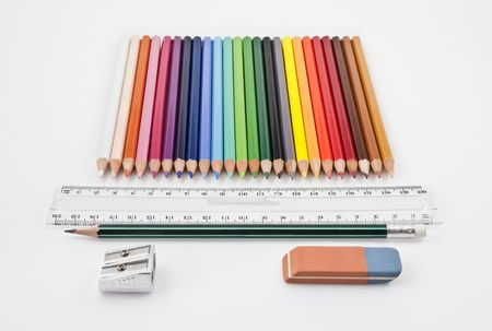 Straight alignment of basic school supplies on a white background Stock Photo